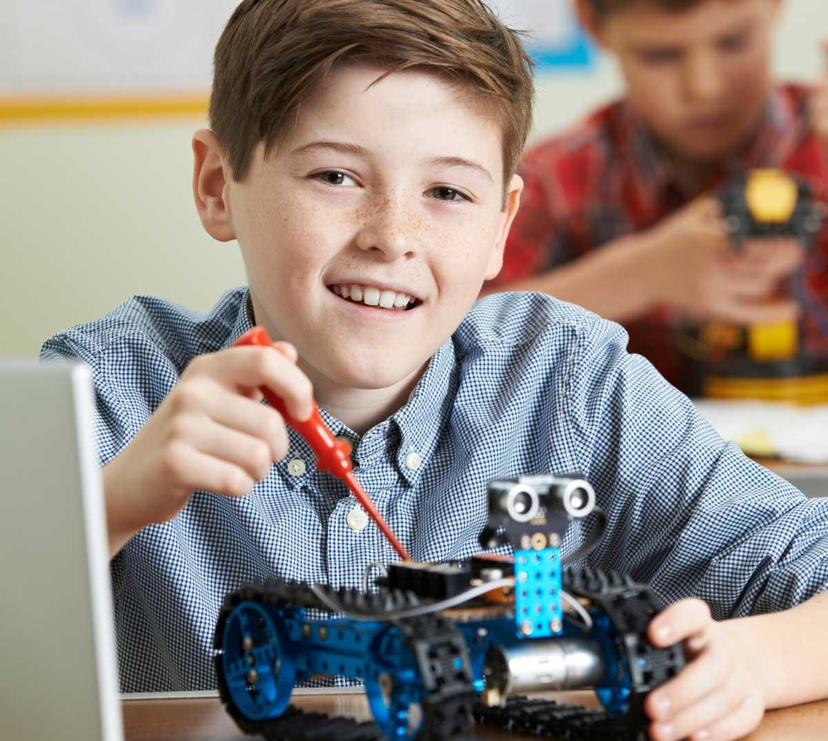 Child working on robot