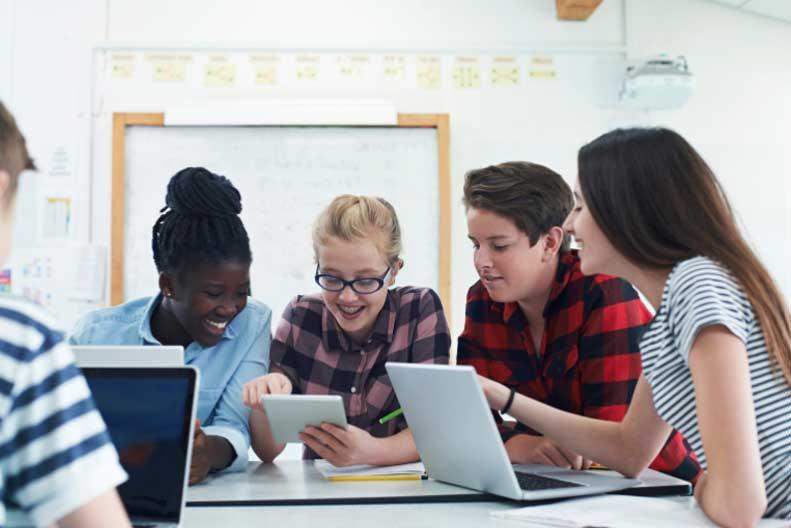 students collaborating on math problem